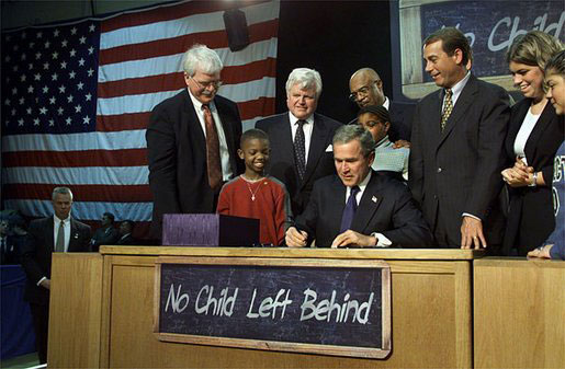 President Bush signing the No Child Left Behind Act at Hamilton H.S. in Hamilton, Ohio.